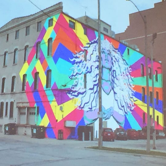 This large mural was proposed for the east side of a building at 302 N. Jackson St. The photo shows a depiction of the mural that presented at a 2016 meeting of the Historic Third Ward Architectural Review Board.