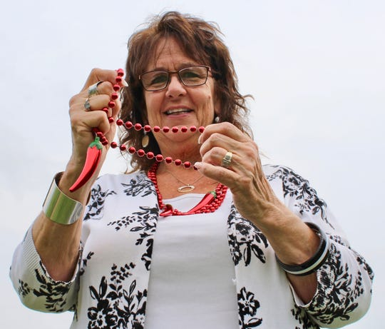 Diana Ogle, who started the Beaver Dam Pepper Festival, displays the fest's signature beads.
