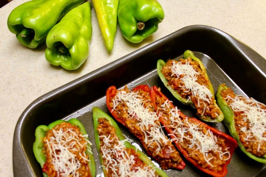 Beaver Dam Peppers are stuffed with a ground beef-rice-tomato mixture, topped with cheese and baked.
