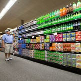 Steve Close of Fox Point shops in an aisle of sodas, energy drinks, drink mixers and more at Sendik's Food Market in Mequon.