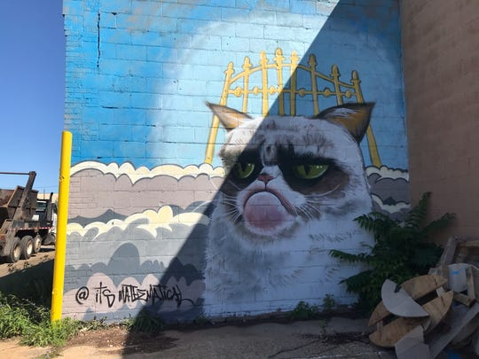 Grumpy Cat may have died, but his grumpy face will live on in this Milwaukee mural