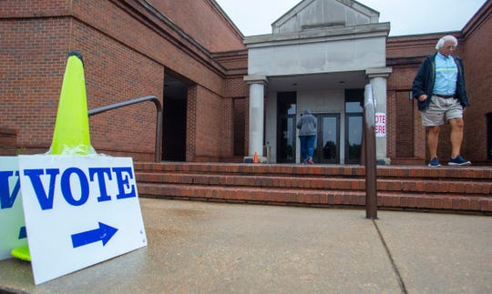 Montgomery residents braved the rain to cast their ballots at the Montgomery Museum of Fine Arts in the municipal elections.