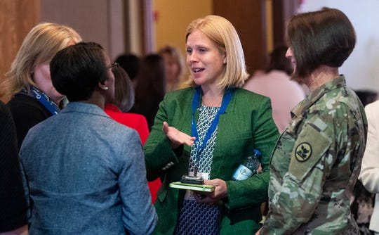 Lauren Knausenberger, Director of Cyberspace Innovation for the U.S. Air Force, chats with local female business leaders at a luncheon in Montgomery, Ala., on Tuesday August 27, 2019.