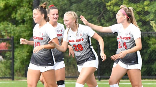 Grace Alsop (center) celebrates with her Ball State soccer teammates. Alsop was named the Mid-American Conference's top offensive player for the week.