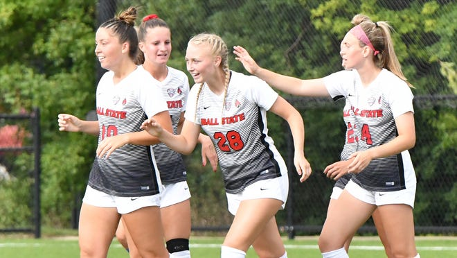 Grace Alsop (center) celebrates with her Ball State soccer teammates. Alsop scored her fourth goal in four matches in Ball State's 2-1 victory over Loyola Chicago Sunday.