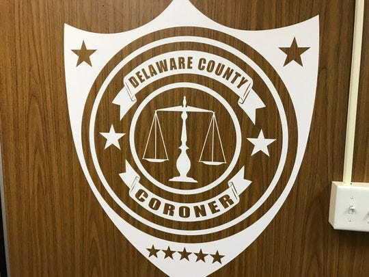 A sign outside Delaware County Coroner Rick Howell's office in the Delaware County Building, 100 W. Main St.