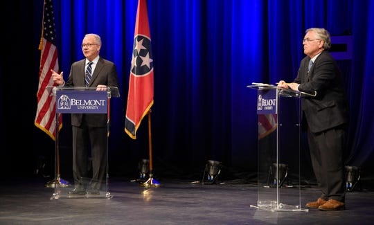 Mayor David Briley speaks as At-Large Metro Councilman John Cooper listens during the mayoral debate at Belmont University on Monday.