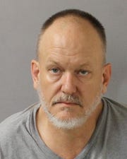 Renny McMahon, 50, is charged with agg. assault and theft after police say he backed a stolen ambulance into a patrol car Monday night on Murfreesboro Pike. Officer Allyson Reis was behind the ambulance when he stopped and backed into her police vehicle. She received minor injuries.