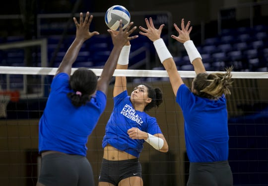 Amanda Carroll, a redshirt senior and outside hitter, hits over her teammates during FGCU volleyball practice on Tuesday. Carroll has 1,395 kills in her career, which is first in FGCU program history. The Eagles open their season on Friday.