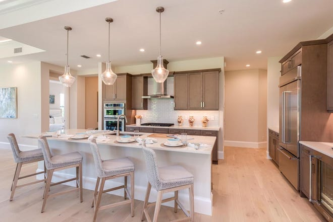 Driftwood tone plank flooring is shown on the Messina model in Corsica at Talis Park.