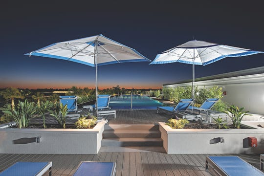 The rooftop pool area features a hot tub and fire pit with vast views of downtown and beyond.