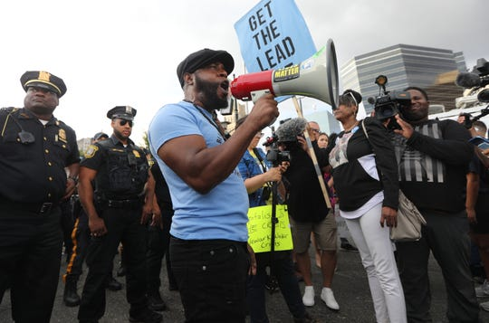 "A man, who goes by the name, Shaka Zulu, of the New African Black Panther Party, screams protest cries into a megaphone, across from the Prudential Center. Protestors outside the MTV Video Music Awards said Newark should take care of its water problem before the awards ceremony. They chanted and held signs that read, ""GET THE LEAD OUT"".  Monday, August 26, 2019"