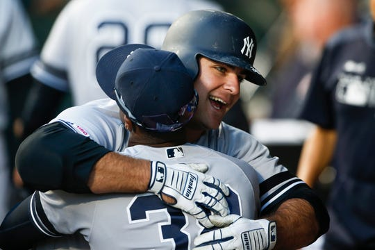 Aug 26, 2019; Seattle, WA, USA; New York Yankees first baseman Mike Ford (36) celebrates in the dugout after hitting a two run home run against the Seattle Mariners during the second inning at T-Mobile Park. Mandatory Credit: Joe Nicholson-USA TODAY Sports