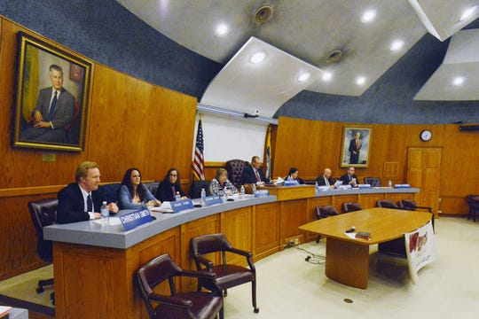 The Wayne Board of Education convenes in the municipal courtroom.