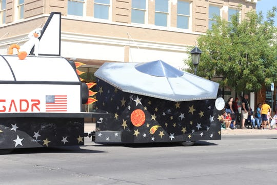 Solitaire Homes took the top prize at the Columbus Electric Co-op Tournament of Ducks Parade. The tail-end of the float featured a racing duck leisurely resting on the tail of a replica space shuttle and an out-of-this-world flying saucer trailing.