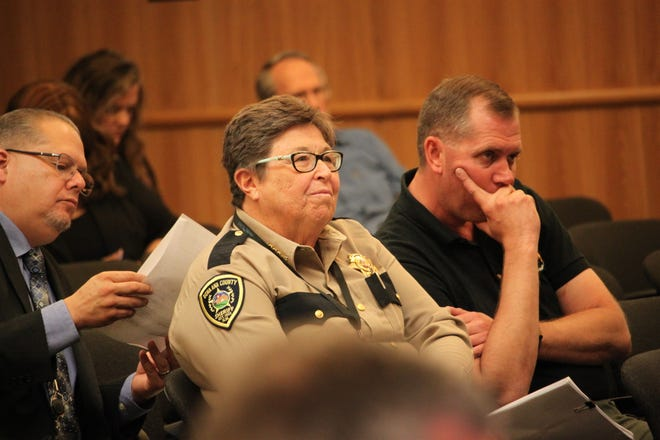 Sheriff Kim Stewart listens as county attorney Nelson Goodin discusses a contract between the sheriff's office and the judicial district during the Doña Ana County Board of Commissioners meeting on Tuesday, Aug. 27, 2019.
