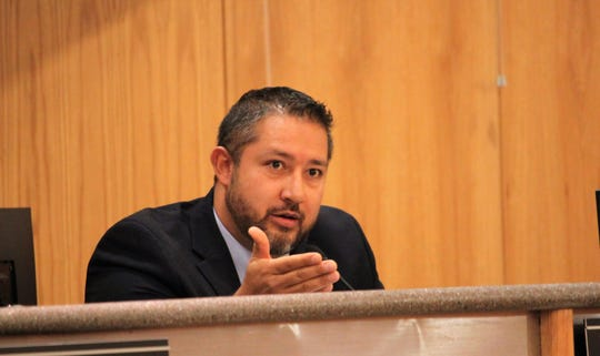 Doña Ana County Commissioner Manuel Sanchez addresses restaurateur Kimberly Yacone during a hearing over a liquor license for Forghedaboudit Southwest Italian Cuisine during the commissioners' meeting on Tuesday, Aug. 27, 2019.