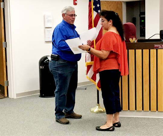 Mayor Cynthia Atencio swears in newly appointed City Councilor Sam Mohler, Monday, Aug. 26, 2019, during a Bloomfield City Council meeting.