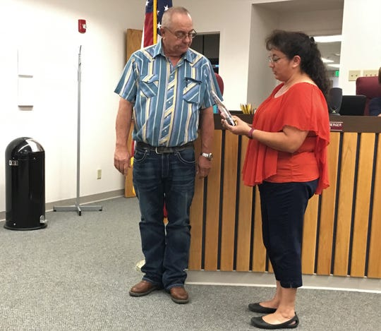 Mayor Cynthia Atencio recognizes former City Councilor Curtis Lynch for his service, Monday, Aug. 26, 2019, during a Bloomfield City Council meeting.