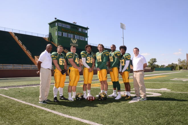 From left to right, Wayne State head coach Paul Winters, Lamar Namou, Will Butler, James Hill, Jacob Mass, Marcus Bailey, Kameron Ford and assistant running backs coach Dylan Dunn.