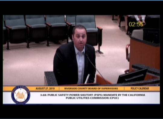 Southern California Edison representative Jeremy Goldman addresses the Riverside County Board of Supervisors meeting on August 27, 2019, about public safety power shutoffs.