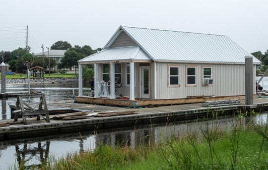 A prototype of a house boat under construction at Pitts Slip nears completion Tuesday. The rental house boats will be part of the new Seville Harbour Marina, if the City Council signs off on a proposed lease.