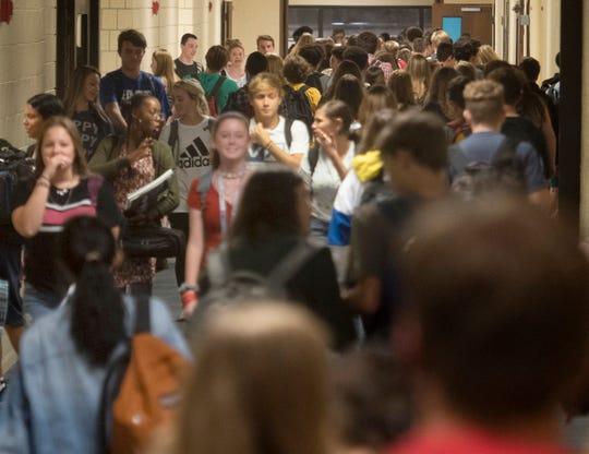 Pace High School students flood the hallways on Tuesday.