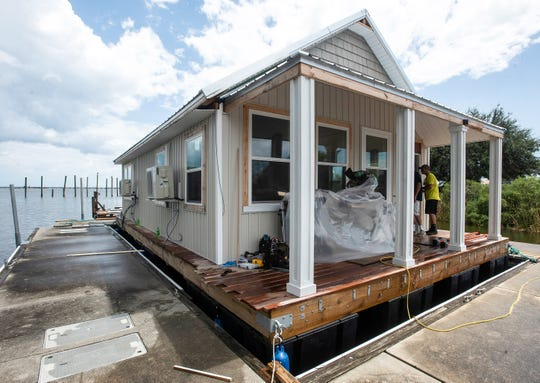 A prototype of a house boat under construction at Pitts Slip nears completion Tuesday. The rental house boats will be part of the new Seville Harbour Marina, if the City Council signs off on a proposed leased.