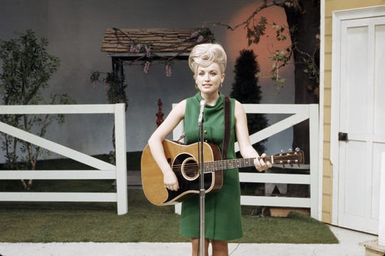 "Dolly Parton on the Porter Wagoner Show in 1967. WSRE will host a preview screening of PBS' new documentary ""Country Music"" on Sept. 5, which explores the genre's history, the lives of country music legends and the unique relationship the music has with fans."