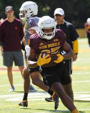 ASU running back A.J. Carter (25) performs a drill during practice at Camp Tontozona earlier this month.