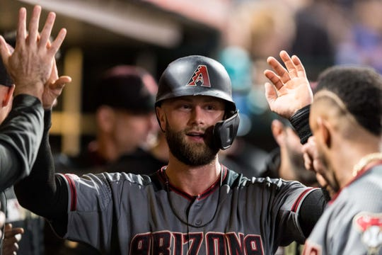Diamondbacks first baseman Christian Walker celebrates in the dugout after scoring against the Giants during the sixth inning of a game Aug. 26 at Oracle Park.
