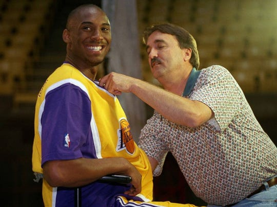 Lakers rookie Kobe Bryant is heckled by his teammates as a cameraman adjusts a microphone on his jersey during media day at the Forum on Oct. 14, 1996.