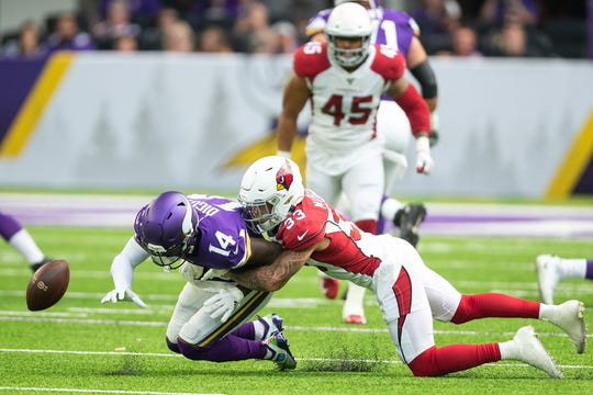 Arizona Cardinals cornerback Byron Murphy (33) breaks up a pass intended for Minnesota Vikings wide receiver Stefon Diggs (14) during the second quarter at U.S. Bank Stadium.