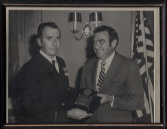 Harry Baish, left, receiving the Pennsylvania State Fireman of the Year award in 1971.
