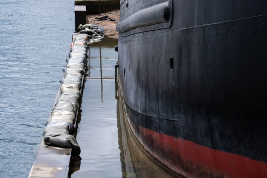 Sandbags are lined up on the breakwall next to the Huron Lightship Museum. Water spilling into the ship's dry dock from the St. Clair River is beginning to cause foundation damage around the museum.