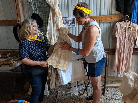 Ellen Wigsten Cannon, left, and friend Martha Smith McCullagh of Easthampton, Massachusetts, examine an item for sale during the Wigsten/Cannon family's barn sale in July.