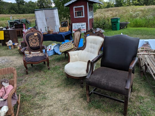A variety of chairs on display for sale at the Wigsten/Cannon family's July barn sale  in Pleasant Valley.