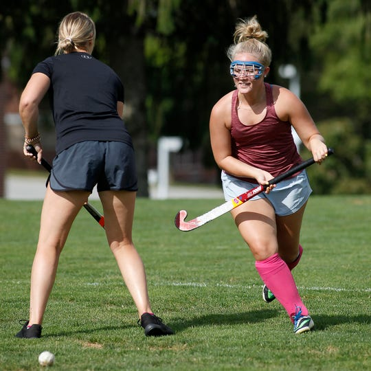 Haley Strayer, left, goes head to head with coach Emily Taylor during Dallastown field hockey practice, Tuesday, August 27, 2019.