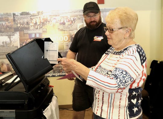 "Peggy Long of Redding gets her ""I voted"" sticker as voting machine clerk Joshua Franks looks on Tuesday, Aug. 27, 2019. Long wore her patriotic red, white and blue shirt to vote at her polling place inside First United Methodist Church for the special primary election for Assembly District 1."