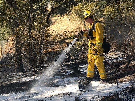 Crews clean up a vegetation fire on Barbara Road