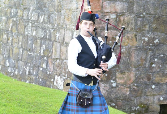 John Elliott plays his bagpipes at  Hermitage Castle in Scotland. The Redding native and his family were invited to visit the castle by the Elliott clan chieftain, Margaret Elliott.