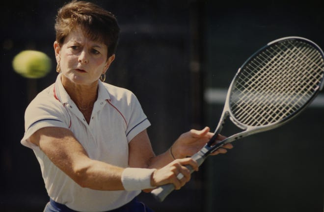 Tennis great Nancy Richey prepares to return a shot while practicing with her brother Cliff in this file photo from 1990.