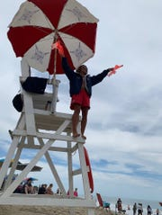RJ Hayman stands atop a lifeguard stand in Ocean City.