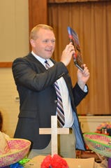 The Rev. Seth Saathoff with a book presented at First Presbyterian of Shreveport Goodbye Luncheon on Aug. 18. Seth and his family have moved to San Antonio where he is the new pastor of Holy  Trinity Presbyterian Church. He was associate pastor at First Presbyterian.
