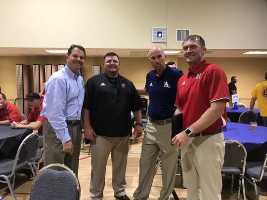 Airline athletic director Ronnie Coker, Parkway coach Neil May, Airline coach Bo Meeks and Haughton coach Jason Brotherton visit during the 66th Bossier Lion's Club Coaches' Dinner Monday night at  Airline Baptist Church.