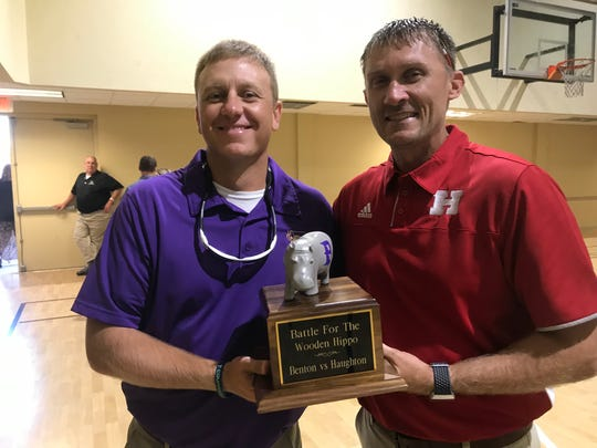 Benton coach Reynolds Moore and Haughton coach Jason Brotherton display the Battle For The Wooden Hippo trophy. The winner of the annual game between the two rivals will get to keep the trophy for a year.