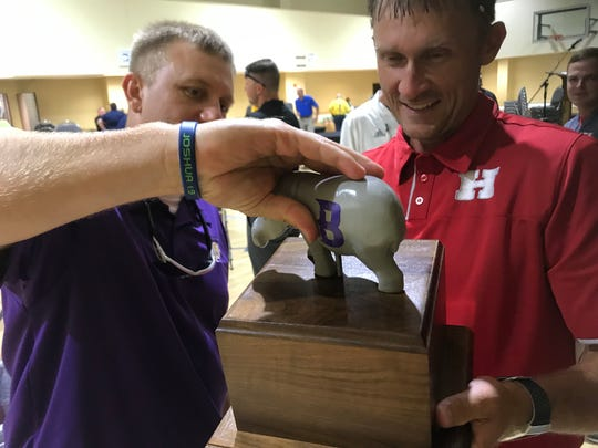 Benton coach Reynolds Moore and Haughton coach Jason Brotherton check out the trophy that will go to the winner of the Battle For The Wooden Hippo.