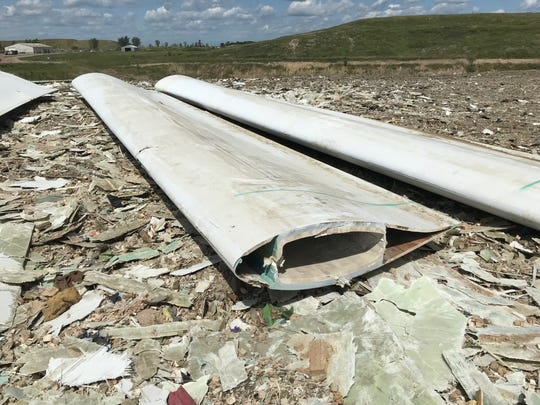 An Iowa wind farm has dumped dozens of old wind turbine blades in the Sioux Falls landfill.