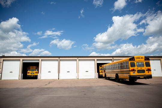 School buses are parked outside of School Bus, Inc. on Tuesday, Aug. 27.