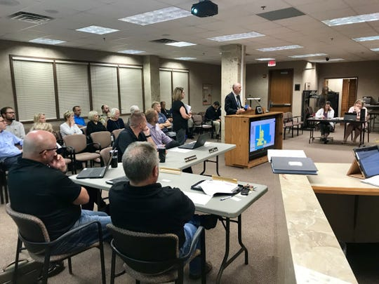 Minnehaha County Planning Director Scott Anderson and Hartford City Administrator Teresa Sidel brief the commission on a proposed joint jurisdiction with the city of Hartford on Tuesday, Aug. 27, 2019.